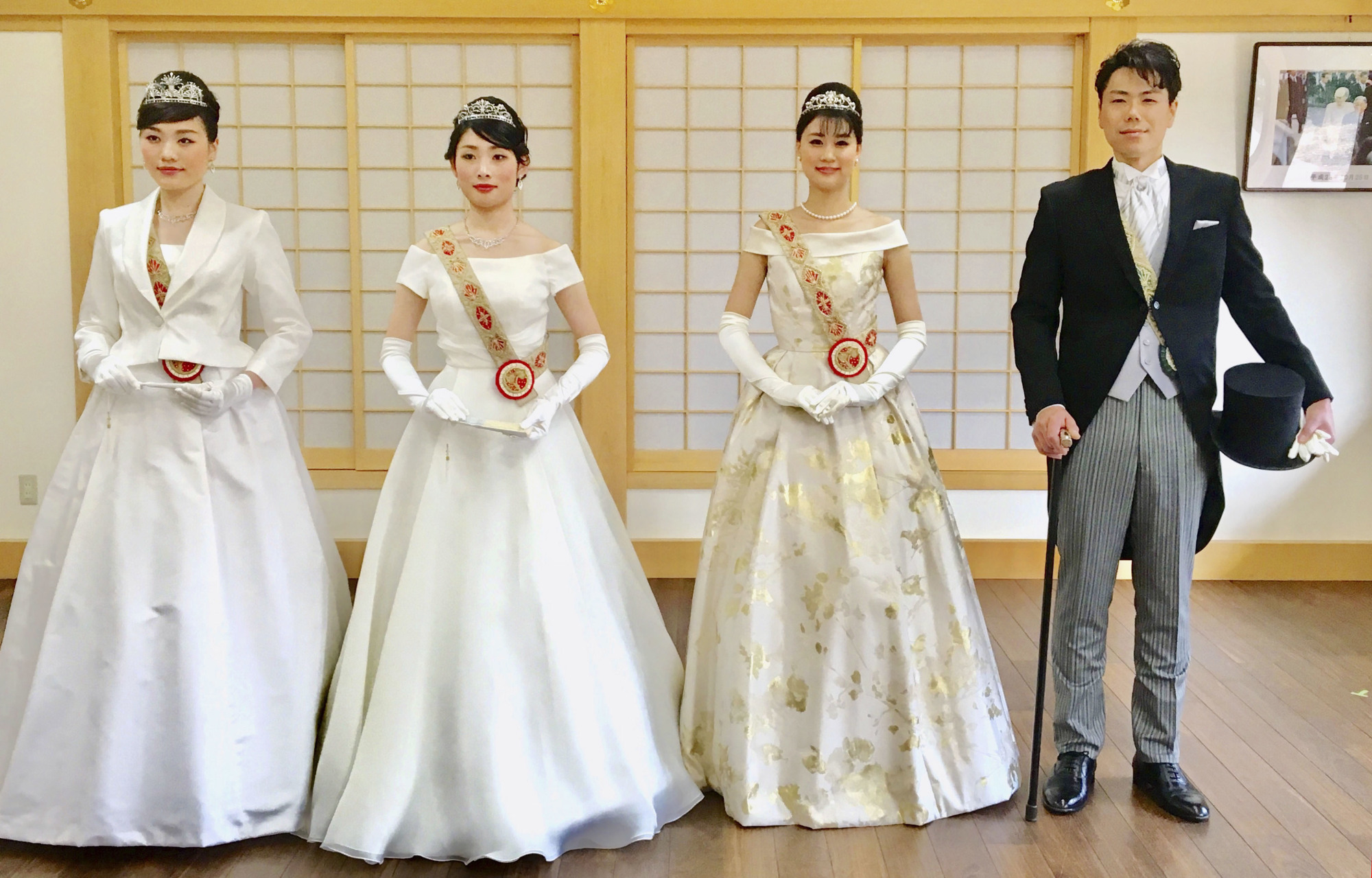 Models show off formal bridal dresses as part of a wedding plan offered by Kamigamo Shrine in Kyoto. Emperor Naruhito's enthronement parade on Sunday is said to have inspired a number of products and services.   KAMIGAMO SHRINE / VIA KYODO