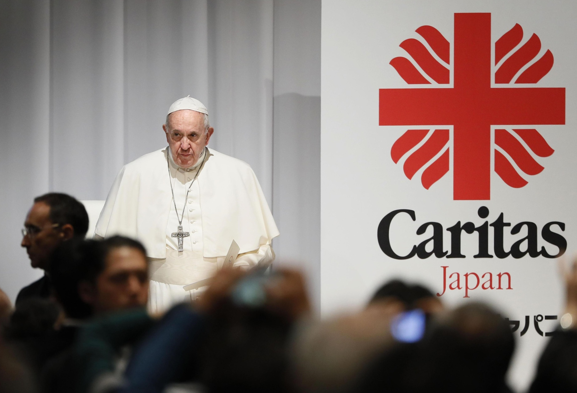 Pope Francis meets with victims of the March 2011 earthquake and tsunami on Monday in Tokyo. | KYODO