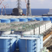 Contaminated water is stored in tanks at the Fukushima No. 1 nuclear power plant in Okuma, Fukushima Prefecture, in February. | POOL / VIA KYODO