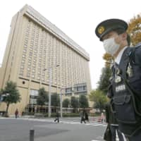 A police officer stands guard Friday near the venue of the Group of 20 foreign ministers' meeting in Nagoya. | KYODO