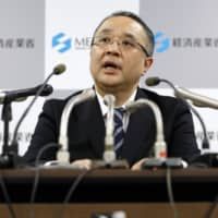 An official from the Economy, Trade and Industry Ministry speaks to reporters about the ministry's export control measures regarding South Korea on Friday. | KYODO