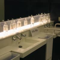Water bottles are placed on washstands in a restroom at Haneda Airport on Wednesday morning after the water supply was cut off at its domestic terminals. | KYODO
