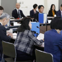 Members of a panel discuss new guidelines for preventing power harassment in the workplace at the labor ministry in Tokyo on Wednesday. | KYODO
