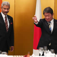 Foreign Minister Toshimitsu Motegi shows the way to Indian Minister of External Affairs Subrahmanyam Jaishankar during a bilateral meeting ahead of the Group of 20 Foreign Ministers' meeting in Nagoya on Nov. 23. | AP