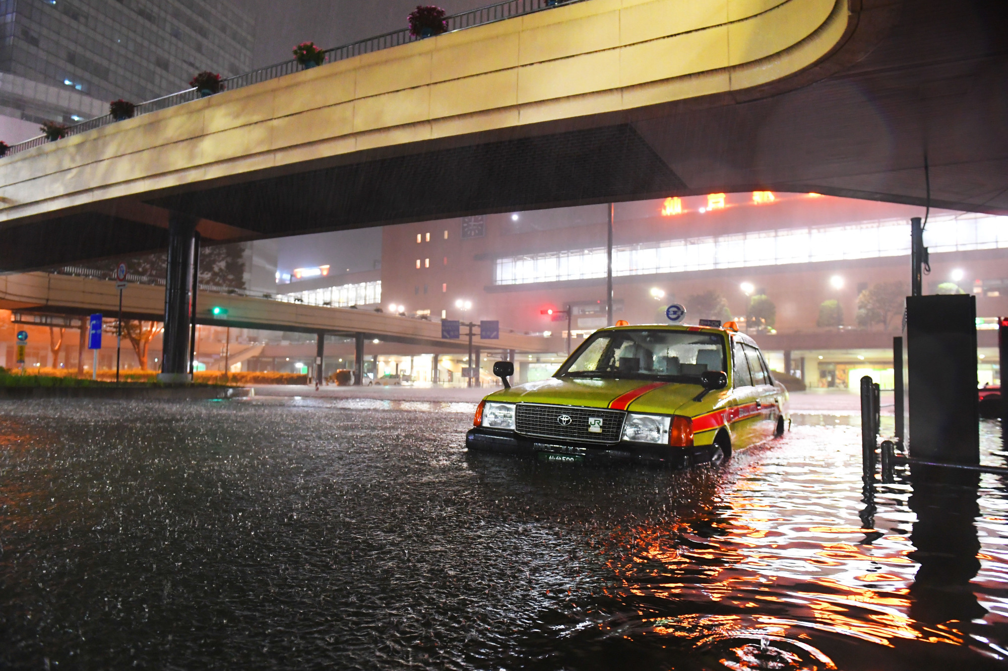 A street in Sendai is flooded on Oct. 13 after Typhoon Hagibis caused heavy rain in the area. | KAHOKU SHIMPO