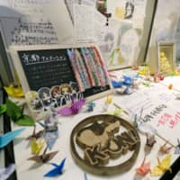 Messages and paper cranes left by fans are seen at a memorial held on Nov. 2 in the city of Kyoto for victims of July's deadly arson attack on a Kyoto Animation Co. studio. | KYODO