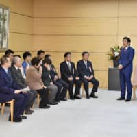 Prime Minister Shinzo Abe meets with relatives of former leprosy patients on Tuesday at the Prime Minister's Office in Tokyo. | KYODO
