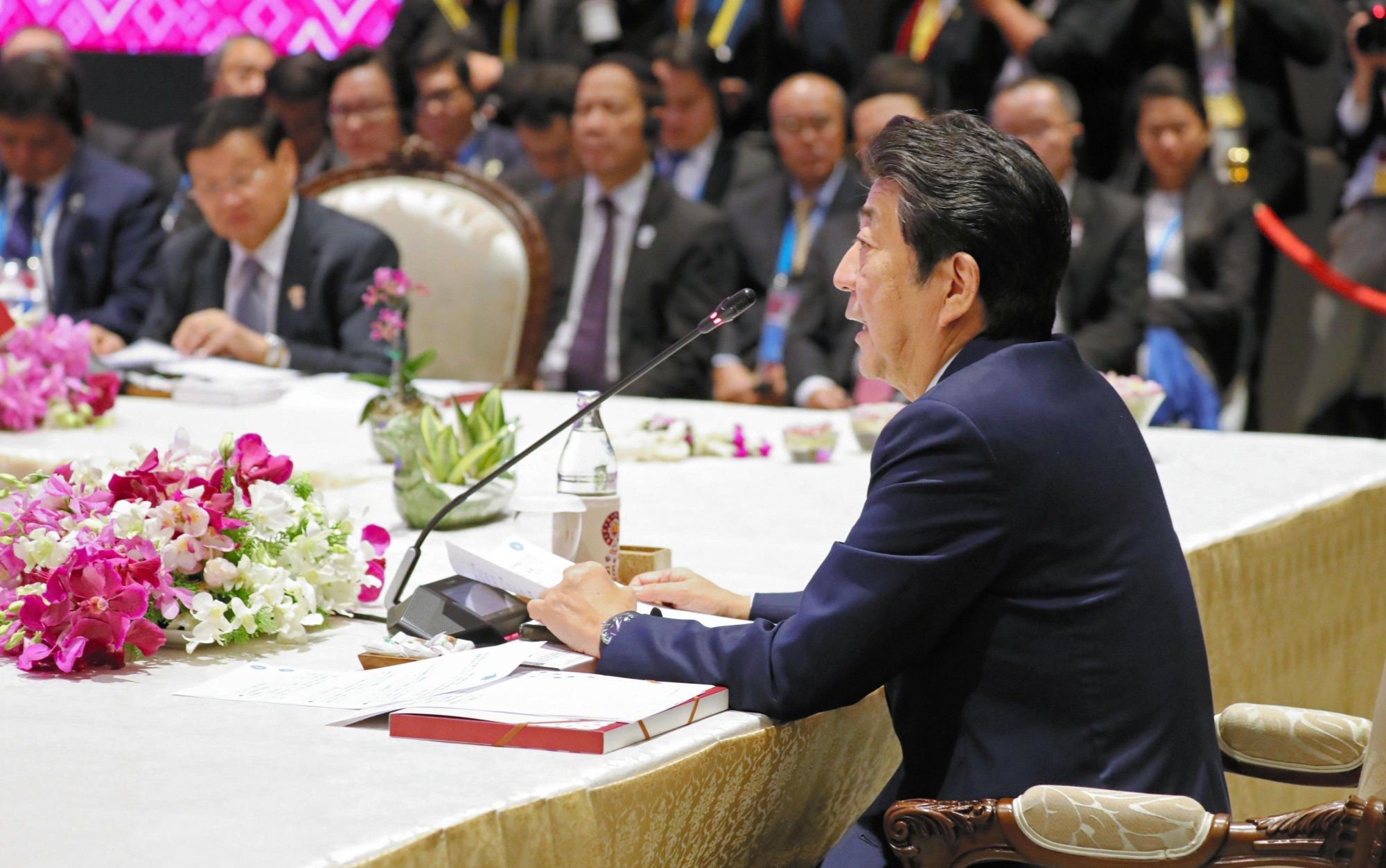 Prime Minister Shinzo Abe speaks at a meeting of the Association of Southeast Asian Nations leaders Monday on the outskirts of Bangkok. | POOL / VIA KYODO
