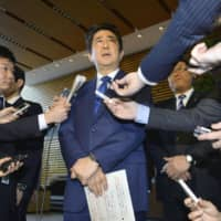 Prime Minister Shinzo Abe speaks to reporters after holding a National Security Council meeting at the Prime Minister's Office in Tokyo in April 2017. | KYODO