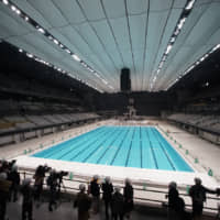 Members of the press view the inside of the Tokyo Aquatics Centre in Koto Ward on Thursday. | RYUSEI TAKAHASHI