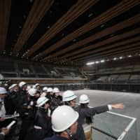 Ariake Arena, which will host volleyball and wheelchair basketball events during the 2020 Tokyo Olympic and Paralympic Games, is shown to the media Thursday. | RYUSEI TAKAHASHI