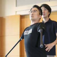 Hirotada Ototake, a writer born without arms and legs and best known for his 1998 best-selling memoir 'No One's Perfect,' is shown in Tokyo on Oct. 10.   KYODO