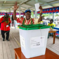 A man prepares to cast his vote in Buka, Papua New Guinea, on Saturday in a historic referendum to decide whether the Bougainville region should gain independence. | AP