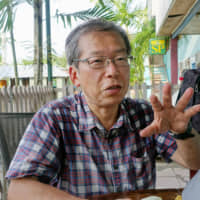 Satoru Kutsukake, a former member of the Japan Overseas Cooperation Volunteers, is interviewed last Thursday in Buka, Papua New Guinea. | ??