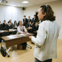 Tetsuya Ando, founder of the nonprofit organization Fathering Japan, gives a training course to new and soon-to-be fathers in Tokyo in 2010. | KYODO