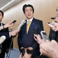 Abe Cabinet approval rate falls below 50% for first time since July as scandal takes its toll, poll shows