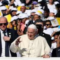 Pope Francis arrives to celebrate Mass at Zayed Sports City Stadium in Abu Dhabi on  Feb. 5. | REUTERS