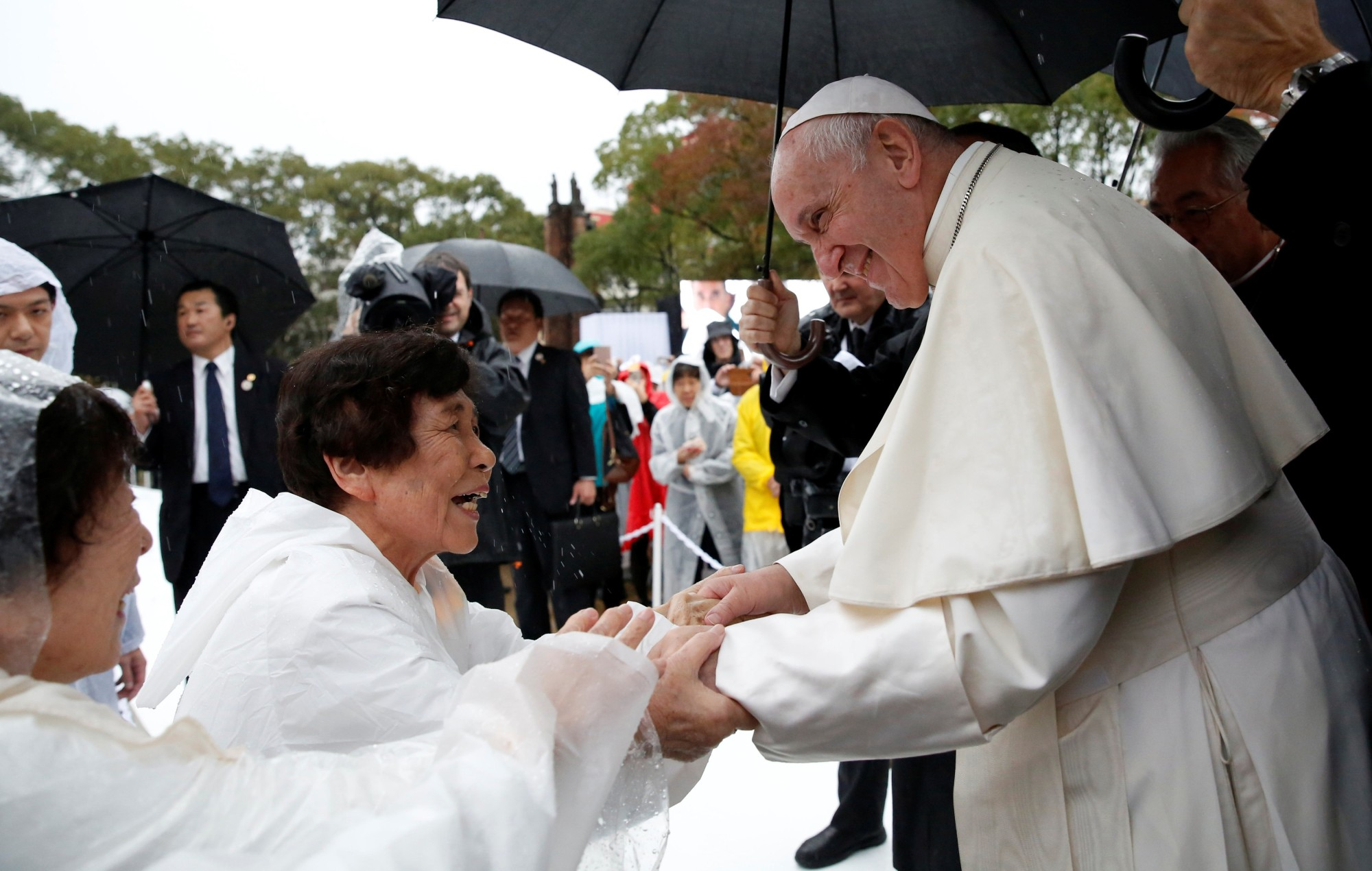 Pope Francis greets well-wishers at the Atomic Bomb Hypocenter Park in Nagasaki on Sunday. | REUTERS
