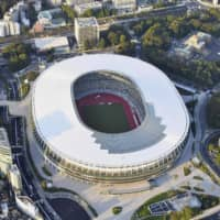 The new National Stadium is shown in Tokyo's Shinjuku Ward in September. Officials from the Tokyo Metropolitan Government revealed Friday that the remains of at least 187 people dating back to the early 1900s or before were retrieved from the Olympic site before construction began. | KYODO