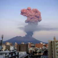 An ash plume from Mount Sakurajima towers over the clouds Friday in this photo by a weather observatory in Kyushu after the volcano had its biggest eruption in more than three years. | KYODO