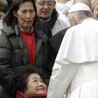 Setsuko Thurlow, who survived the 1945 U.S. atomic bombing of Hiroshima, is greeted by Pope Francis during the weekly general audience in St. Peter's Square at the Vatican on March 20. | AP / VIA KYODO