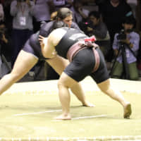 Hiyori Kon  (right), the 22-year-old subject of the Netflix documentary 'Little Miss Sumo,' competes in the Women Sumo World Championships in Osaka on Oct. 13. | YUKA OKUTOMI HANDOUT VIA THOMSON REUTERS FOUNDATION (NO ARCHIVE / NO RESALES)