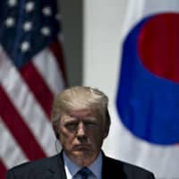 U.S. President Donald Trump listens during a joint statement in the Rose Garden of the White House with South Korean President Moon Jae-in, in June 2017. | BLOOMBERG