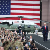 U.S. President Donald Trump arrives to address U.S. military personnel at Osan Air Base in Pyeongtaek, South Korea, on June 30. | BLOOMBERG