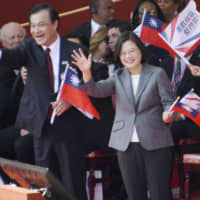 Taiwanese President Tsai Ing-wen (right) waves during a parade in Taipei on Oct. 10.   KYODO