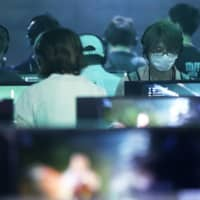 In a survey of Japanese age 10 to 29, those who said they played video games for six hours or more per day stood at 2.8 percent for weekdays and 12 percent for holidays. | BLOOMBERG