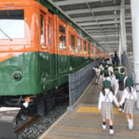 School children enjoy the Promenade, which displays trains from different eras at the Kyoto Railway Museum. | JASON JENKINS