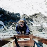 Rung after rung: The author climbs one of the ladders leading to the peak of Mount Yari, devoid of hikers during the winter off-season.   CAPELLA YEE
