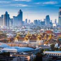 City of smiles, city of contrasts: Bangkok's Grand Palace is in direct contrast with the city's rapidly growing skyline   GETTY IMAGES