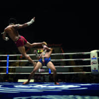 High-flying action: A muay thai fight at Lumpinee Stadium, which holds televised fights most evenings of the week.   PEERAPONG PRASUTR VIA WIKIMEDIA COMMONS / CC BY-SA 4.0