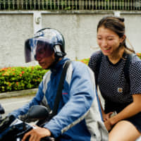 Daily necessity: Beat the notorious Bangkok traffic by riding a moto taxi around the city. The drivers are skilled, and cut through the traffic by alarmingly narrow margins.   OSCAR BOYD