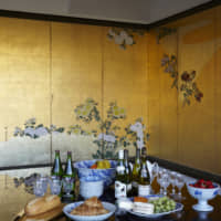 Gallery wall: Private concerts at the Takishita residence are followed by buffet-style refreshments. A friend gave Takishita the idea of utilizing this six-panel byōbu from the Edo Period— which can form a perfect right angle when folded in the middle — for corner arrangements like this one.
