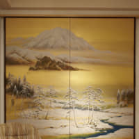 Mix and match: In a quiet corner of the house, Takishita raised this Taisho Era (1912-26) screen off the floor so that the painting can be enjoyed by someone seated on the sofa. The landscape is painted on silk. Using metal or wood brackets to hang byōbu on a wall makes them easy to put up and take down. When clients purchase screens from Takishita's collection, he provides custom-made brackets.