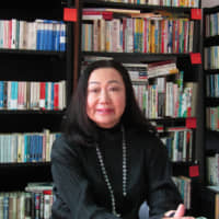 Reading is fundamental: Yuko Yamashita sits in the Japanese library she created out of an office in Barcelona. | ANNETTE PACEY