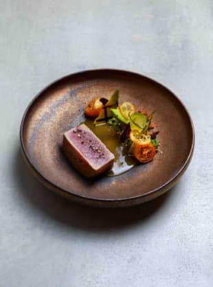 Pret-a-porter deluxe: A dish of tuna, avocado and kumquat from Esterre's menu, designed by French chef Alain Ducasse. | COURTESY OF ESTERRE