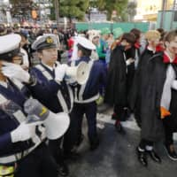 Crowd control: Costume-clad people gather for Halloween celebrations in Tokyo's Shibuya entertainment district on Oct. 31, 2018. | KYODO