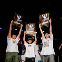 From left: Yoshiki Tomiyama, Tsukki Iinuma and Sho Sato celebrate after winning a chance to represent Japan at the 22nd Pessac Battle Arena break-dancing tournament in France. | DAN SZPARA