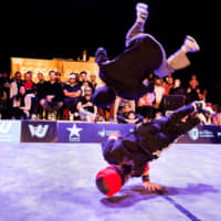 Sho Sato (above) and Tsukki Iinuma compete at the 22nd Pessac Battle Arena break-dancing competition in November. | COURTESY OF VIBRATIONS URBAINES / PESSAC BATTLE ARENA