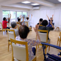 Residents of Yuimarl Jinnan participate in an exercise routine. | COURTESY OF COMMUNITY NET