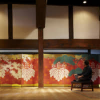 Two of a kind: A pair of six-panel folding screens, featuring cherry and pine boughs against a samurai-era battle-camp curtain sporting family crests in the classic goshichi no kiri (five-seven-five paulownia) style, stretches the length of the main hall of the Takishita residence. The room's central pillar conceals the gap between the two screens. Although byōbu  were often created in pairs, few perfect sets like this one remain intact today. Yoshihiro Takishita admires the Meiji Era (1868-1912) screens from a low chair once used for meditation by Chinese monks.