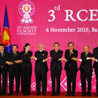 Prime Minister Shinzo Abe and other world leaders pose for a group photo during the third Regional Comprehensive Economic Partnership (RCEP) summit in Bangkok on Monday. | AFP-JIJI