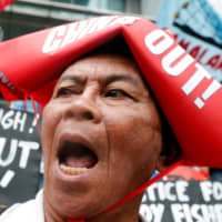 People in Manila protest Chinese harassment of Filipino fishing crews in the South China Sea in June 2018. | REUTERS