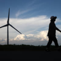 A wind turbine stands in Koriyama, Fukushima Prefecture. Last year, renewable energy sources excluding large-scale hydroelectric plants accounted for a mere 8 percent of Japan's total power supply | BLOOMBERG