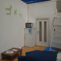 A model of an apartment room with 'gomen' ('sorry') written on the wall. | ALEX MARTIN