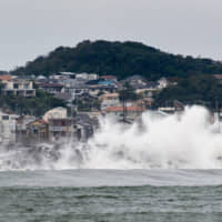 Waves pummel a breakwater in Fujisawa, Kanagawa Prefecture, as Typhoon Hagibis approaches on Oct. 11. Japan has much at stake in the effort to combat climate change. | BLOOMBERG
