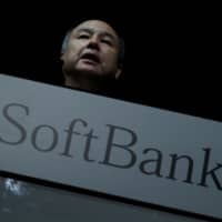 SoftBank Group Corp. Chief Executive Masayoshi Son attends a news conference in Tokyo on Tuesday. | REUTERS